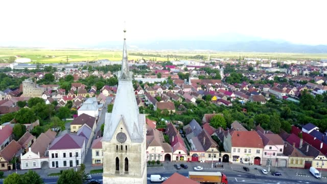 flyby near codlea's fortified church tower - transylvania stock videos & royalty-free footage