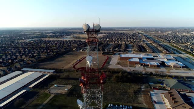 fly-by of microwave communications tower in frisco texas - microwave tower stock videos and b-roll footage