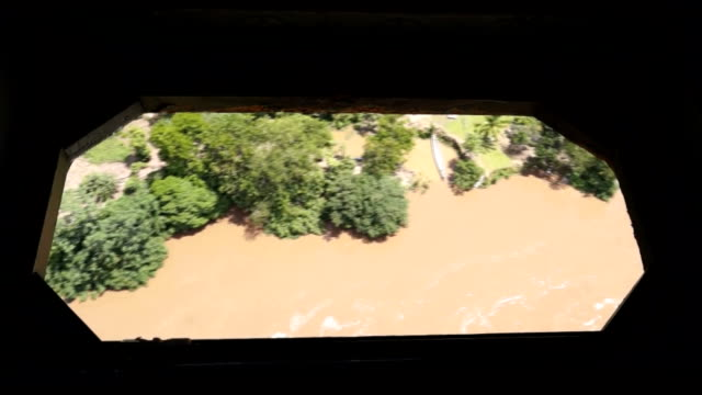 flyby of rainforest filmed from helicopter hatch. - heckklappe teil eines fahrzeugs stock-videos und b-roll-filmmaterial