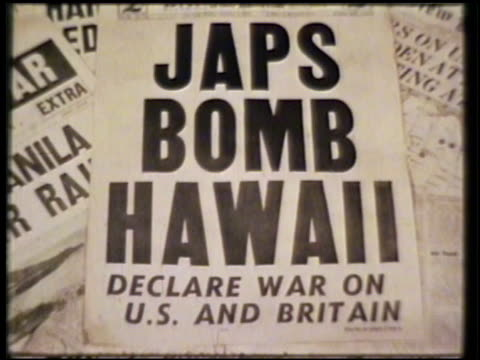 flyer on top of pile of newspapers flyer reading 'japs bomb hawaii declare war on us and britain' wwii world war ii pearl harbor day of infamy... - report document stock videos & royalty-free footage
