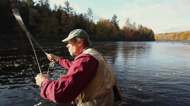 ws zi pan fly-fisherman casting fishing line in river / the forks, maine, usa - fishing rod stock videos & royalty-free footage