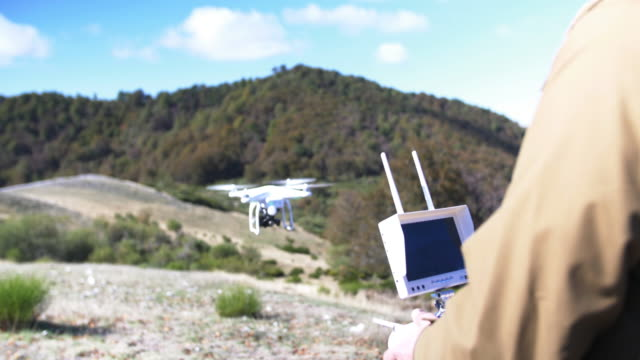 flying a drone in the mountains - pilot stock videos & royalty-free footage