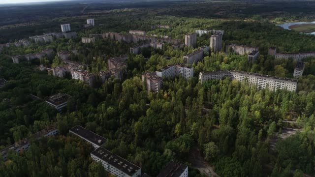 flying a drone over the abandoned city of pripyat - nuclear reactor stock videos & royalty-free footage