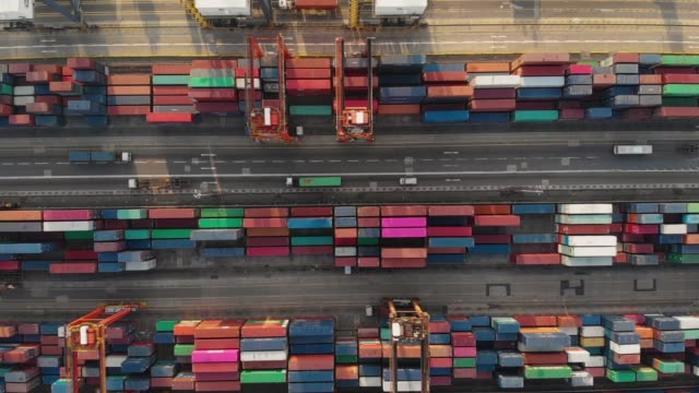 flying above and dolly forward of container ship in industrial port. - manufacture stock videos and b-roll footage