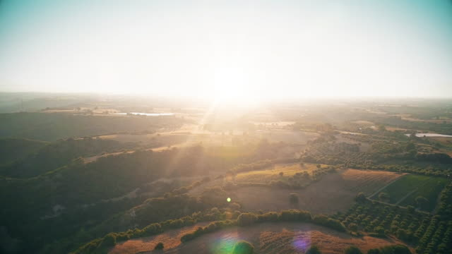 flying above fields at sunset - valle video stock e b–roll