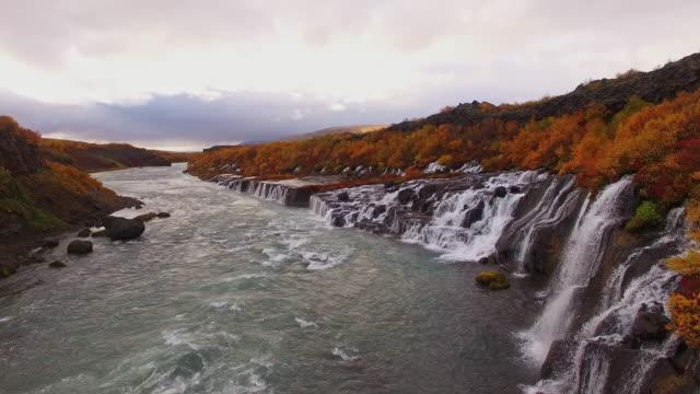 AERIAL Flying above Hraunfossar waterfall