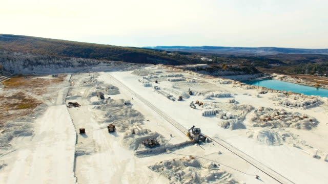 aerial: flying above limestone quarry - quarry stock videos and b-roll footage
