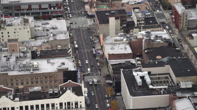 flying above martin luther king boulevard and the apollo theater in harlem, new york city. shot in november 2011. - artbeats bildbanksvideor och videomaterial från bakom kulisserna