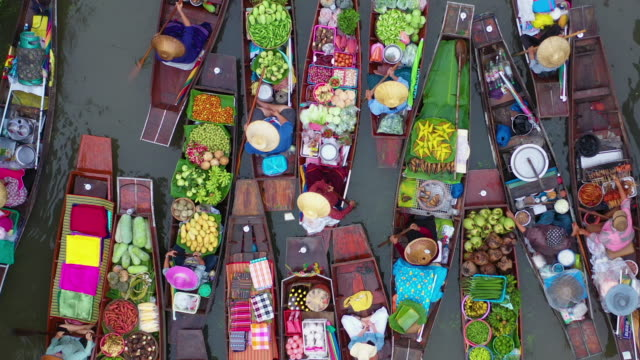 flying above of of colourful floating market - thai culture stock videos & royalty-free footage