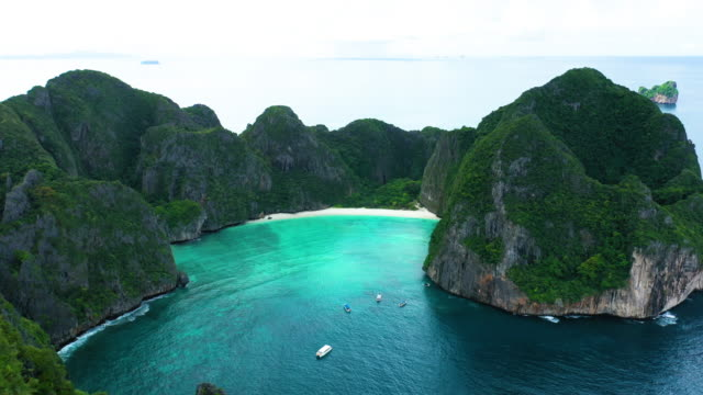flying above of phi phi le, phi phi islands, thailand - phi phi le stock videos & royalty-free footage