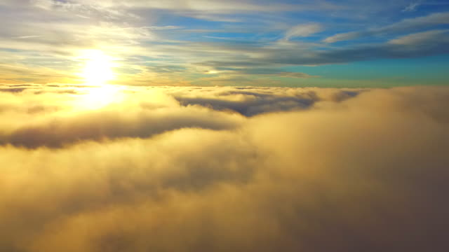flying above real clouds with a drone - sunlight stock videos & royalty-free footage