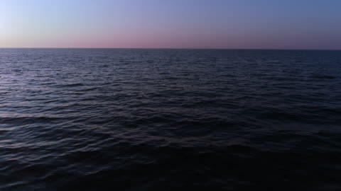 flying above sea water surface towards horizon - water surface stock videos & royalty-free footage