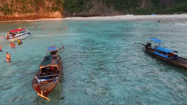 flying above the boats on the sea into the maya bay,phi phi le island - phi phi le stock videos & royalty-free footage