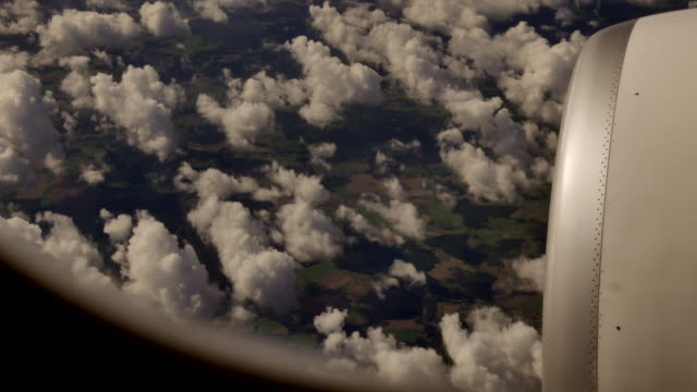 flying above the clouds. airplane window view. high in the sky background - windows stock videos and b-roll footage