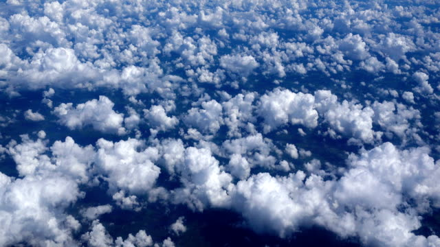 flying above the clouds in vivid color - passenger point of view stock videos & royalty-free footage