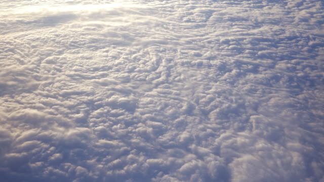 flying above the clouds - fluffy stock videos & royalty-free footage