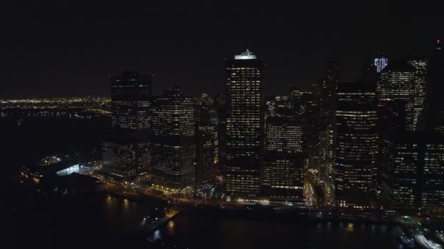 Flying above the East River at night, looking west to Financial District. Shot in 2011.