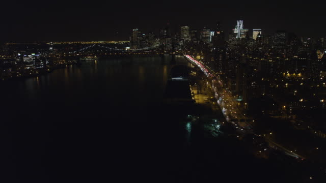 Flying above the East River toward the Manhattan Bridge at night. Shot in 2011.