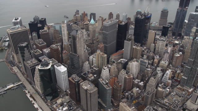 Flying above the Financial District toward the tip of Lower Manhattan. Shot in 2011.