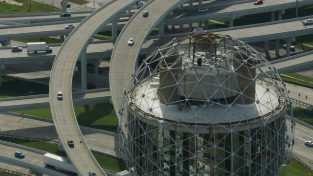 flying above the mixmaster freeway interchange with the reunion tower in the foreground - texas stock videos & royalty-free footage