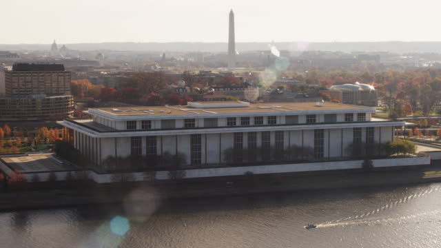 Flying above the Potomac past the Kennedy Center in Washington DC; United States Peace Institute and Washington Monument at right and rear. Shot in 2011.