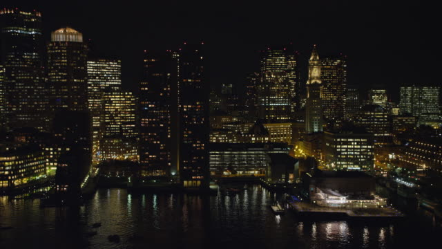 Flying above waterfront in downtown Boston at night. Shot in 2011.
