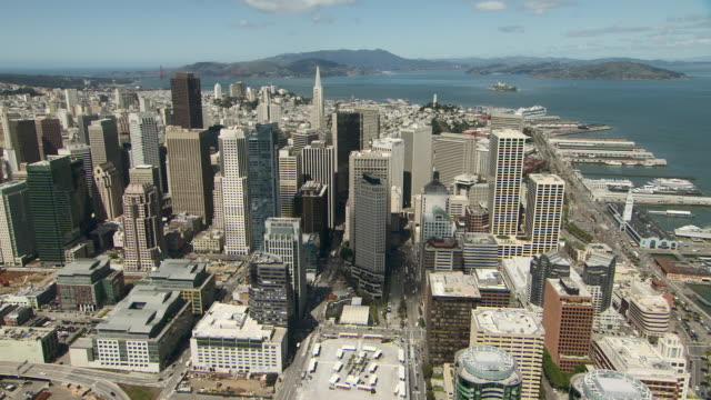 flying across the city of san francisco, from the oakland bay bridge and the financial district toward the marina district. - vista marina stock videos & royalty-free footage