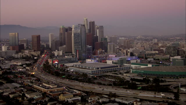 stockvideo's en b-roll-footage met aerial sunset flying along downtown la *la convention center la live entertainment complex ritzcarlton hotel tower highway and highrise buildings of... - los angeles convention center