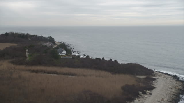 flying along fishers island south shore, new york. shot in november 2011. - artbeats stock videos & royalty-free footage