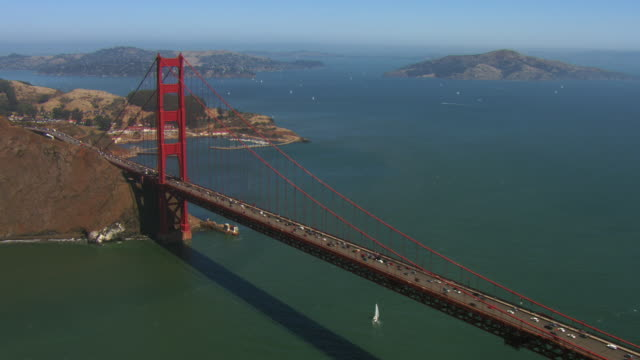 flying along golden gate bridge - san francisco california video stock e b–roll