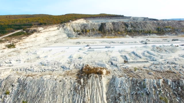 AERIAL: Flying along limestone quarry