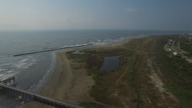 flying along louisiana coast - drone aerial view 4k prawn fishing, shrimp boat, trawler, trawling for ocean fish in the open sea, heavy waves and nets in the water on louisiana, mississippi coast, gulf coast 4k transportation - louisiana stock videos & royalty-free footage