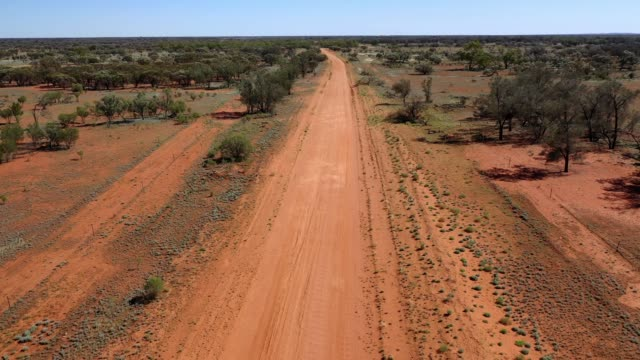 flying along red dirt road, road trip in outback australia - outback stock videos & royalty-free footage