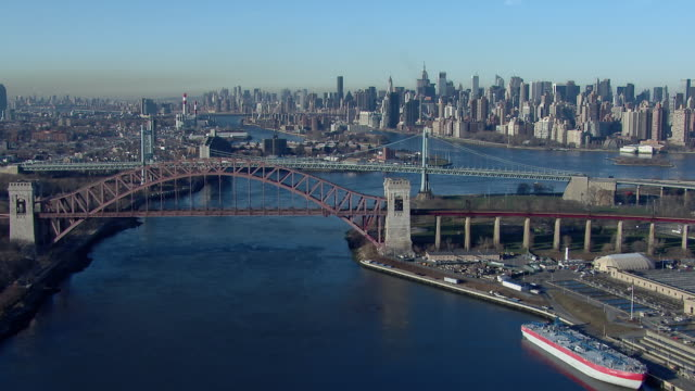 Flying along the East River from Astoria, Queens toward Manhattan in New York City.