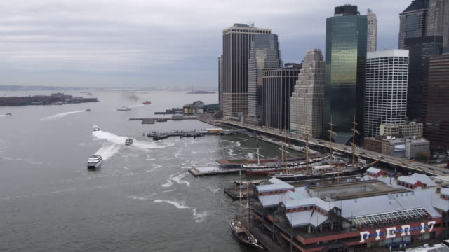 stockvideo's en b-roll-footage met flying along the east river from pier 17 past the financial district toward battery park. shot in 2011. - lower manhattan