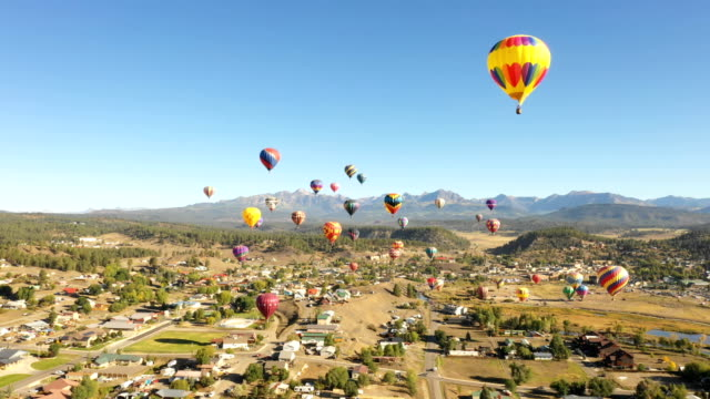 Flying Around Beautiful Balloons Above City in Colorado