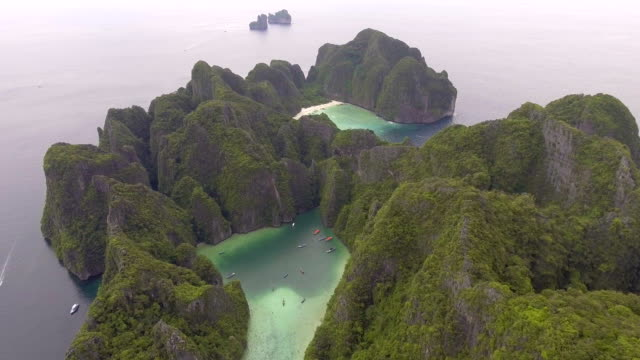 Flying around Beautiful Sea Lagoon and White Beach with Crystal-clear Water with drone, Aerial view
