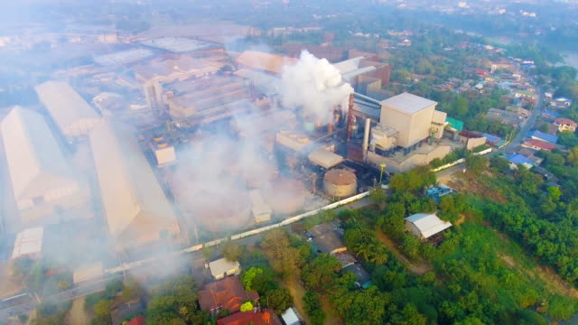 Flying around Smoke chimneys with white smoke while sugar produce with drone, Aerial video