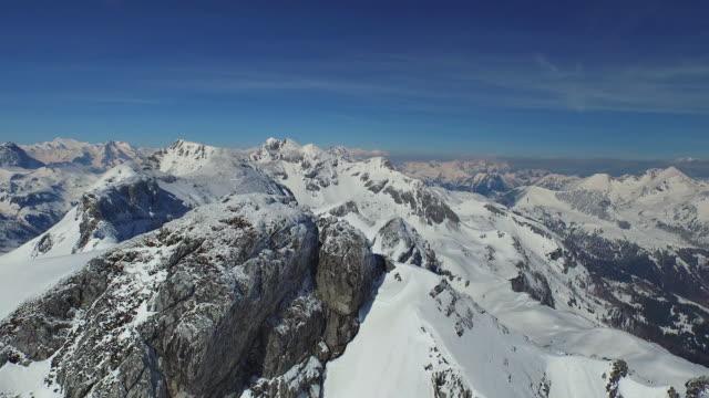 flying around summit cross in winter