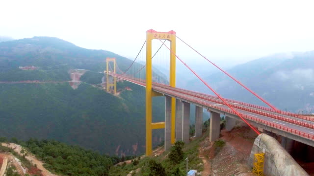 Flying Around Suspension Bridge Connect Between the Mountain, Ghuizhou, China. Aerial video