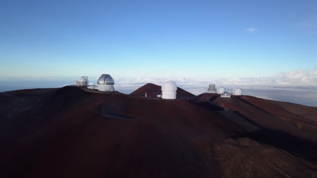 flying around the mauna kea observatory summit in the morning, hawaii. usa - big island hawaii islands stock videos & royalty-free footage