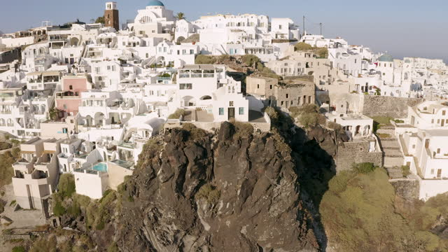 flying away from a church built on the rock in santorini, greece - cyclades islands stock videos & royalty-free footage