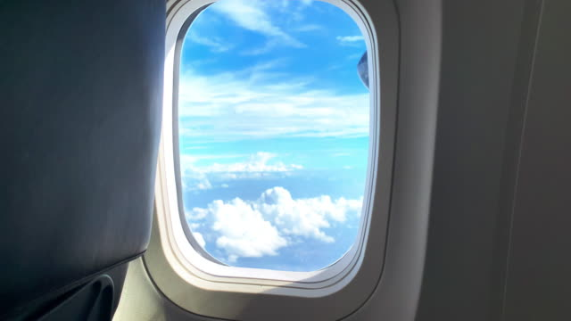 flying away to our next holiday destination - 4k footage from a commercial airliner window - aircraft carrier stock videos & royalty-free footage