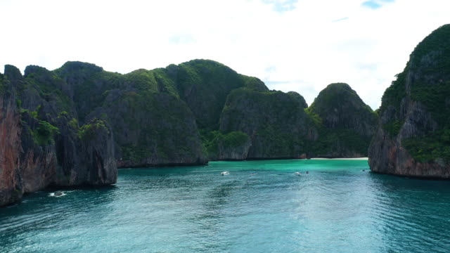 flying backward of phi phi le, phi phi islands, thailand - phi phi le stock videos & royalty-free footage