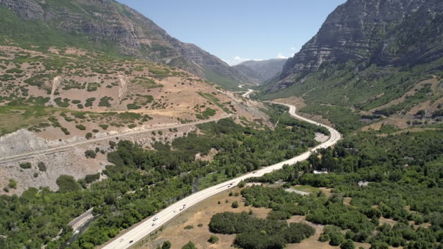flying backwards over winding roads through canyon - provo stock videos & royalty-free footage
