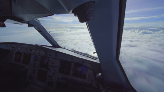 flying between clouds (cockpit pov shot) - cockpit stock videos & royalty-free footage
