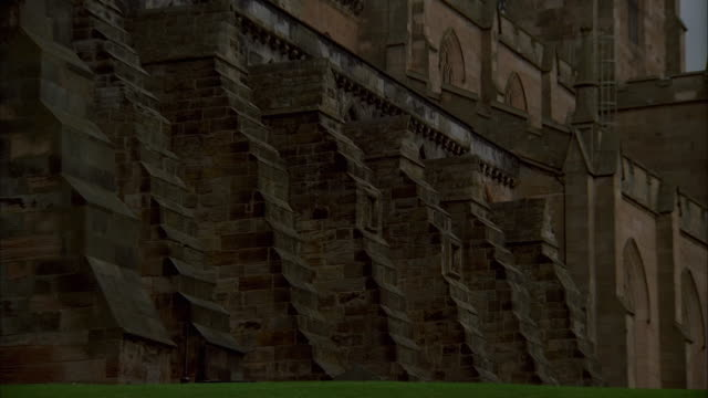 flying buttresses bolster dunfermline abbey in fife, scotland. available in hd. - dunfermline stock videos & royalty-free footage