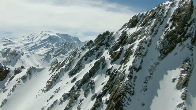 flying by andes mountain peaks in chile - mountain range stock videos & royalty-free footage