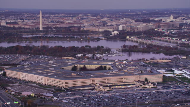 flying by the pentagon with columbia island marina behind; potomac river and washington dc in background. shot in 2011. - the pentagon stock videos and b-roll footage