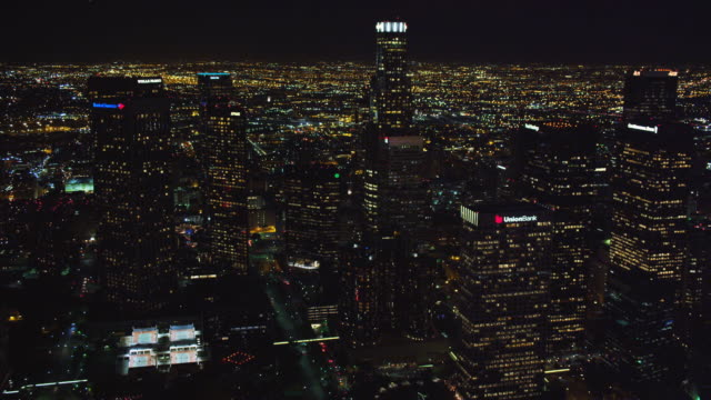 Flying by the skyscrapers of downtown Los Angeles at night. Shot in October 2010.